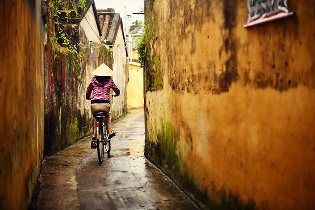 Local people riding bike in an alley
