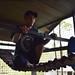 Enrichment member Pak Hendri testing out the strength of the rope bridge in the indoor orangutan enclosure