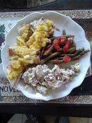 Great supper by my wife Janice. Pork tenderloin with home made honey mustard onion spread, green beans with tomatoes and home made red potato salad with blue cheese crumbles.