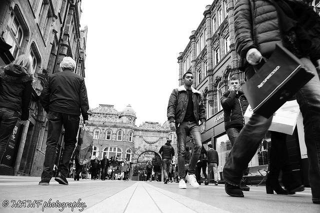 Busy Leeds street scene.