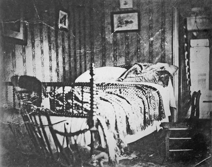 Bed in which Abraham Lincoln died, in the Petersen House, Washington, D.C. Julius Ulke, who was a boarder at the house where Lincoln died, took this photograph shortly after the President's body was removed. Courtesy of Chicago History Museum [ICHi-11209].
