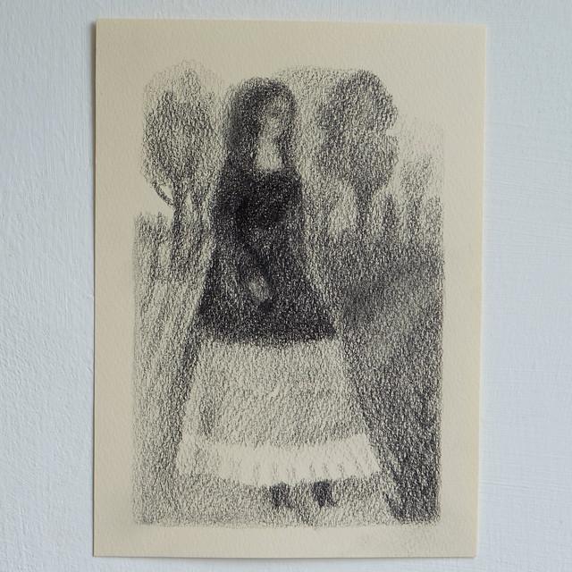 woman walking across the park