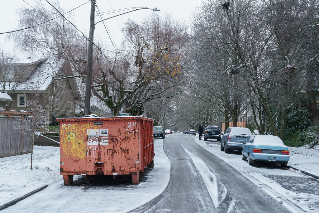 A woman scrapes ice from her car windows on Christmas morning in the Irvington neighborhood of Portland, Oregon