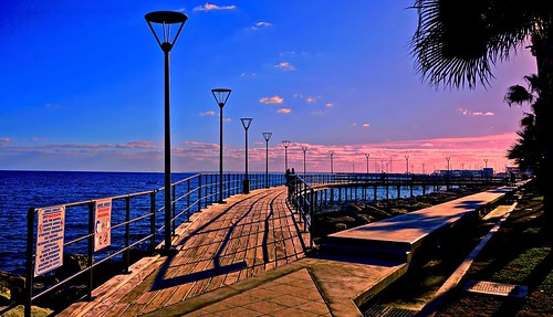 beautiful blue boardwalk city clouds colorful cyprus eu europe lights limassol mediterranean nyandreas pier pink sea serene shadow sky spectacular streetlights sunset trees water waterfront landscape seascape sony6000 travel shadows dusk evening afternoon waterway walkway