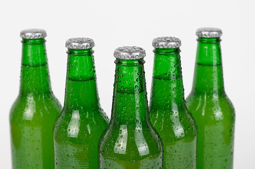 Beer bottles stacked isolated on white background | by wuestenigel
