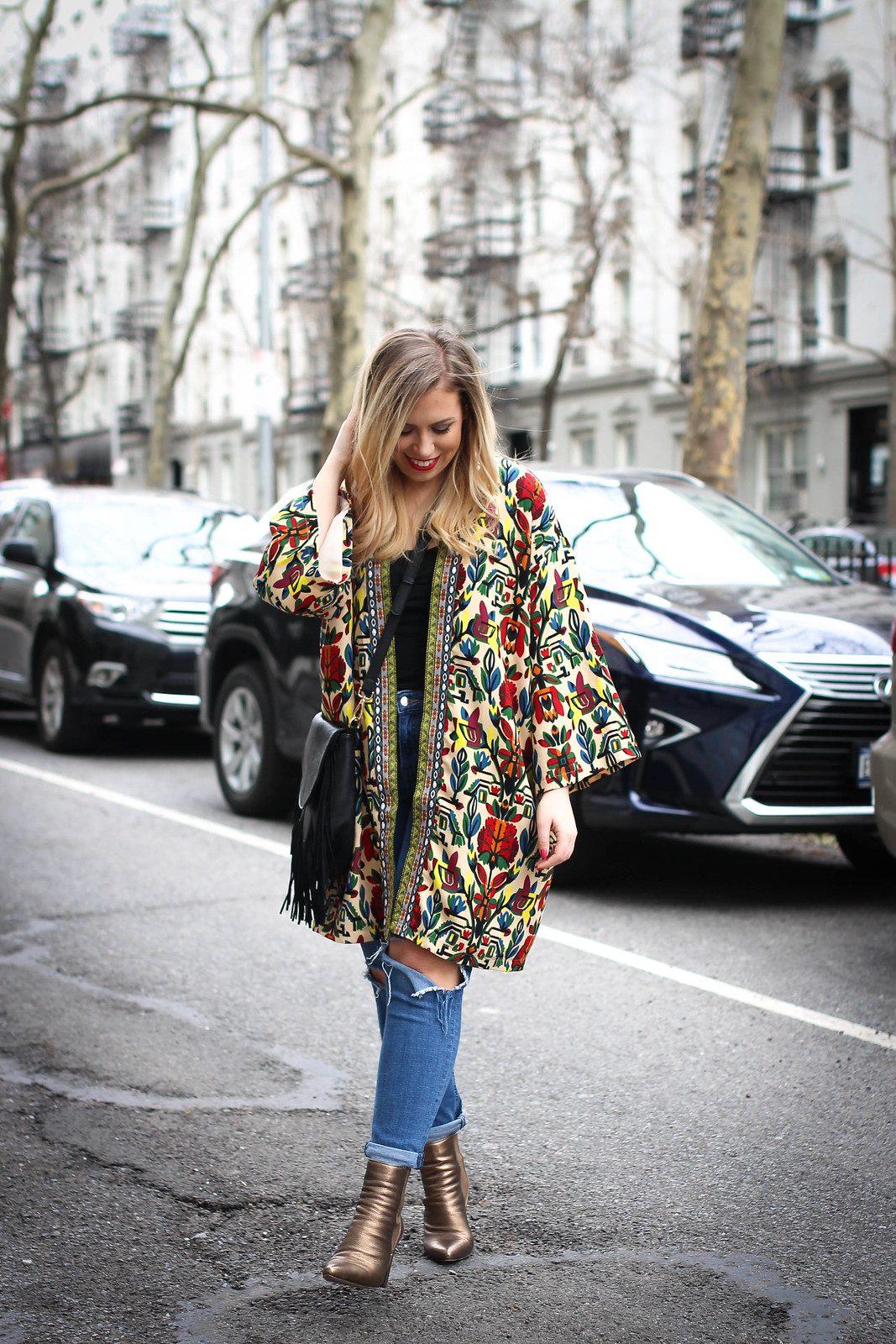 Inexpensive Spring Outfit Idea New York City Fashion Colorful Printed Coat Distressed Denim