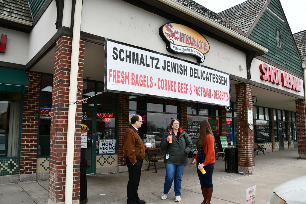 John, Katherine and Melanie talk outside Schmaltz Delicatessen, Naperville, IL