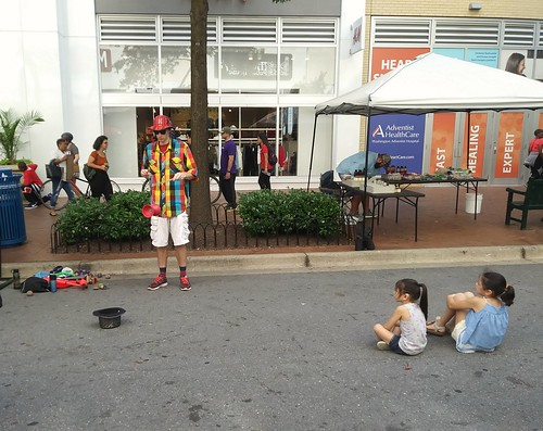 Children watching a street performer on Ellsworth Ave. in Silver Spring, Maryland