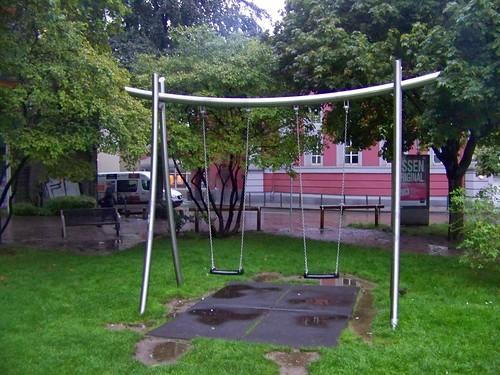 Swing set in the Essen pedestrianized Downtown, note the use of long lasting stainless steel