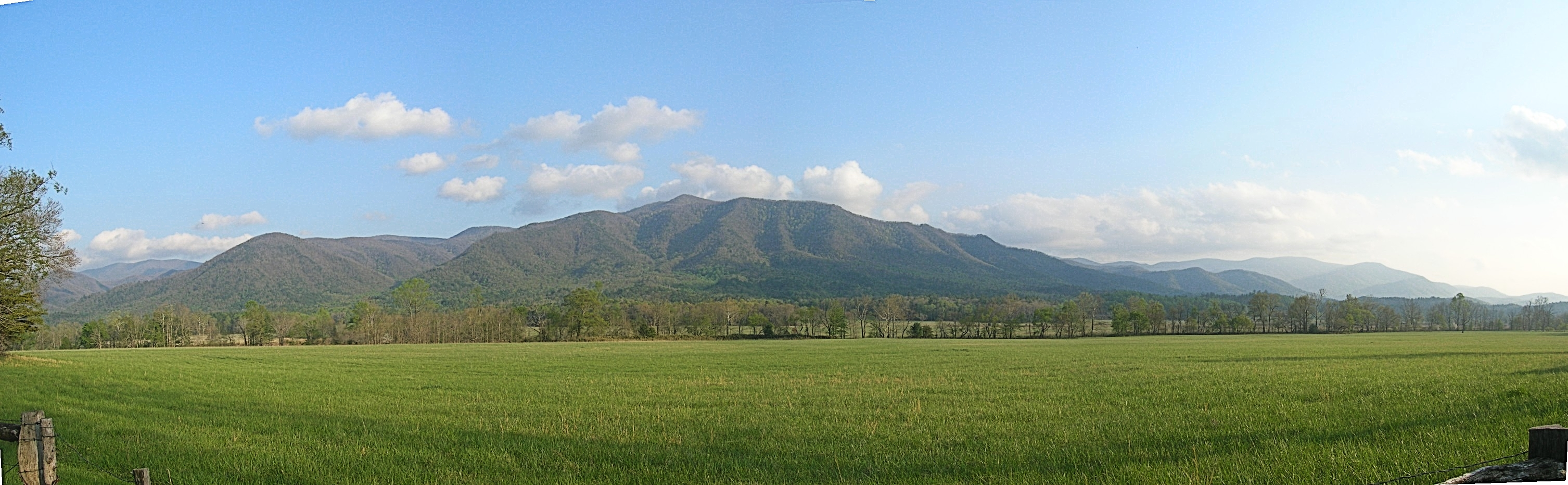 The scenic mountain valley setting of Cade's Cove makes it a popular destination for tourists in the w:Great Smoky Mountains. Photo taken by Anthony Chavez in August 2010.