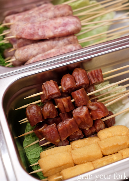 Taiwanese sausage, Cantonese sausage and cheese fish tofu skewers at Granny Wolf BBQ in Central Park Mall Sydney