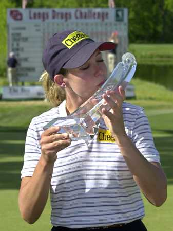 Cristie Kerr kisses the trophy she received for winning the LPGA Longs Drugs Challenge at the Twelve Bridges Golf Club in Lincoln, Calif Sunday April 21 2002 penis juxtaposition
