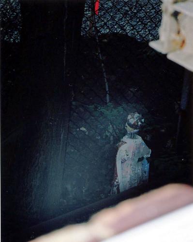 voodoo doll outside window