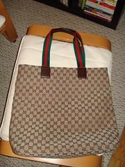 furniture(0.0), bed(0.0), car seat(0.0), bag(1.0), art(1.0), pattern(1.0), textile(1.0), brown(1.0), handbag(1.0),