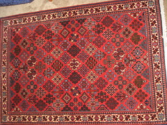 design(0.0), rug(1.0), tapestry(1.0), floor(1.0), art(1.0), textile(1.0), red(1.0), maroon(1.0), prayer rug(1.0), carpet(1.0), flooring(1.0),