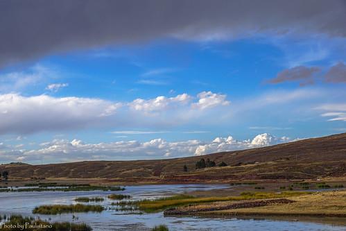 travel peru andes altiplano landscape mountains sillustani sky cloud lake umayo grass water tree