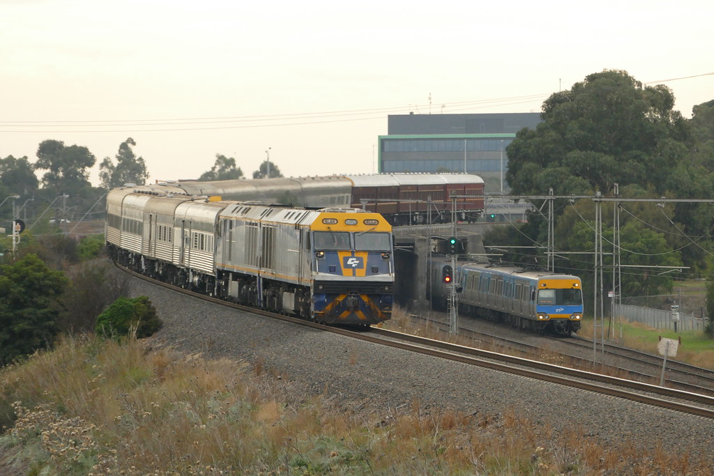 EL64-EL63 as 6L62 anzac special to ararat race past a comeng set on the up at jacana by roreeves