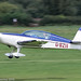 G-BZII - 1999 build Extra EA.300L, arriving on Runway 26L at Barton