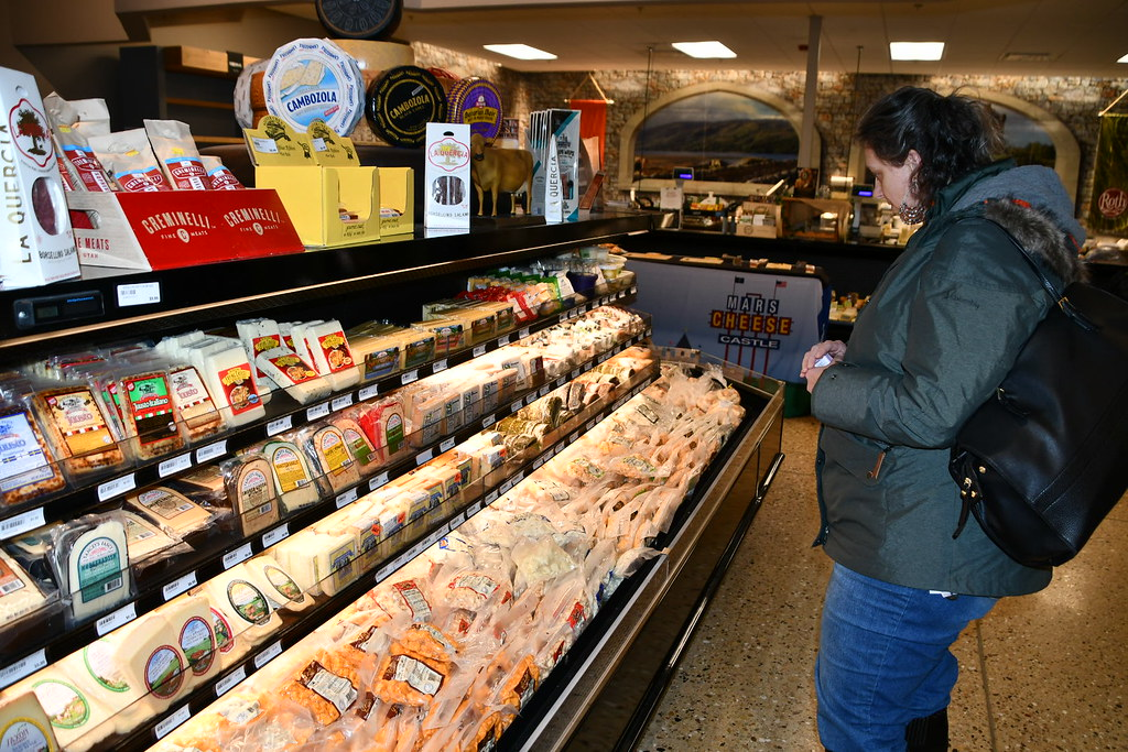 Katherine looks at the variety of flavored cheese curds for purchase.
