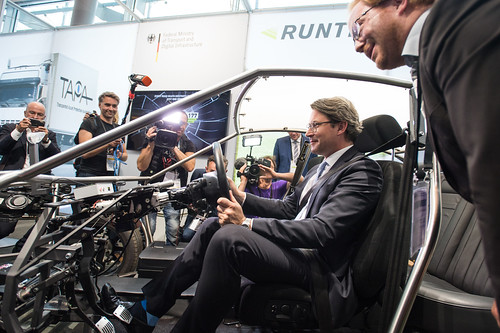 Andreas Scheuer enoys the ride in the gas-free car at the DVR exhibition stand