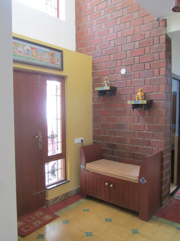 A traditional Karaikudi style Indian home with exposed brick wall and Athangudi tiles