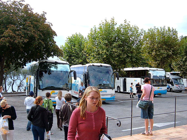 The line up of Contiki_buses_in_Èze shows clearly that Contiki is just another Bus Touring Company, but one that has cleverly marketed to 18-35 year olds.