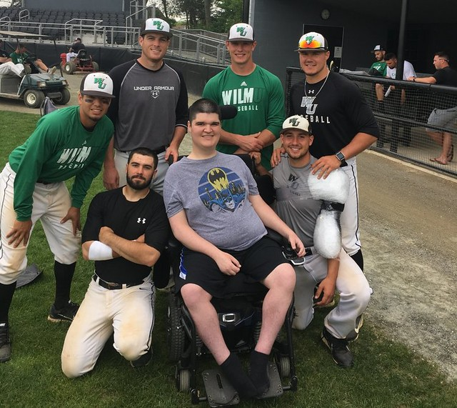 Muscle Movement Champion Mike Smith, of the Muscle Movement Foundation, celebrates WilmU Wildcats Baseball Team win with his teammates, who helped advance the team to the CACC Tournament on May 10.