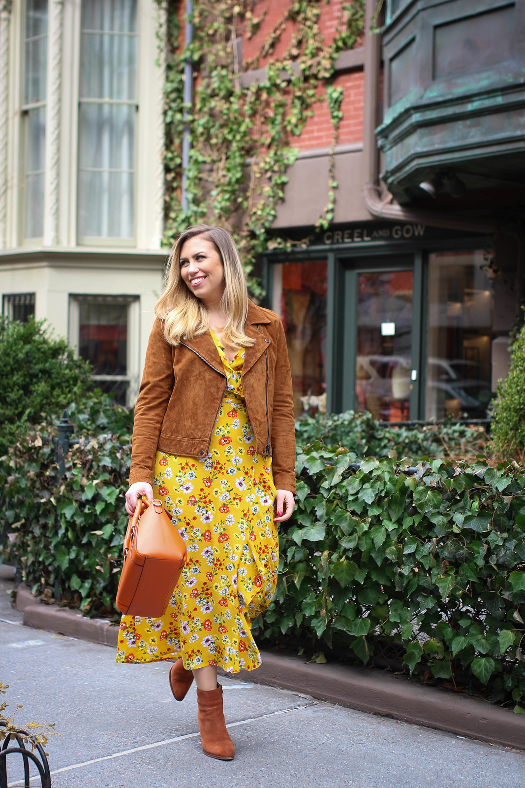 Yellow Floral Maxi Wrap Dress Suede Moto Jacket Orange Bag Suede Booties Spring in NY Outfit Inspiration Fashion Blogger Jackie Giardina