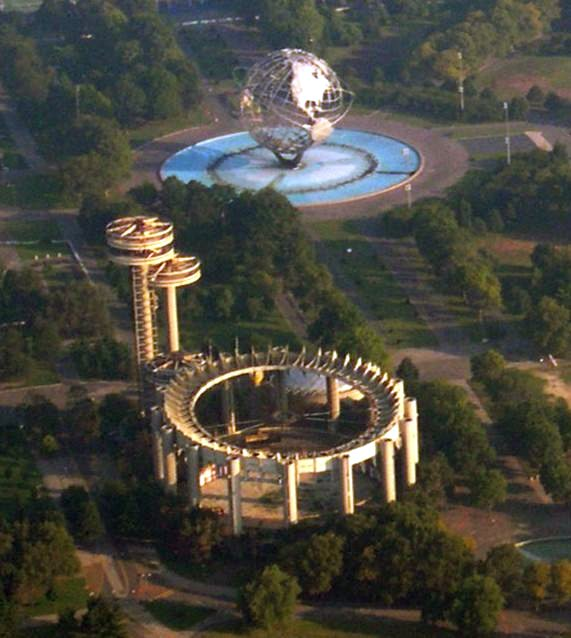 Aerial view of some remaining structures in Flushing Meadows in 2004, including the ruins of the New York State Pavilion in the foreground.
