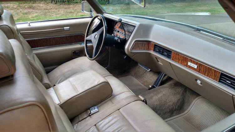 1970 Cadillac Coupe DeVille Sunroof car.