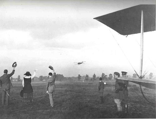 The first flight on May 15, 1918, is airborne with Lt. Boyle circling the Washington Polo Grounds prior to heading to Philadelphia by flying south.