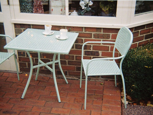 Table, chair and coffee cups