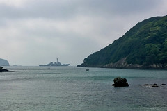 SHIMODA, Japan (May 18, 2018) The guided-missile destroyer USS Curtis Wilbur (DDG 54) sits at anchor off the coast of Shimoda during the 79th Black Ship Festival. The Navy's participation in the festival celebrates the heritage of U.S.-Japanese naval partnership first established by Commodore Matthew Perry's 1853 port visit. (U.S. Navy photo by Daniel A. Taylor)