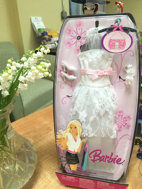 If you look at the lower right cornder of where the gown is folded, just under the Barbie name, you'll see the worn area on the fabric.  Weird...