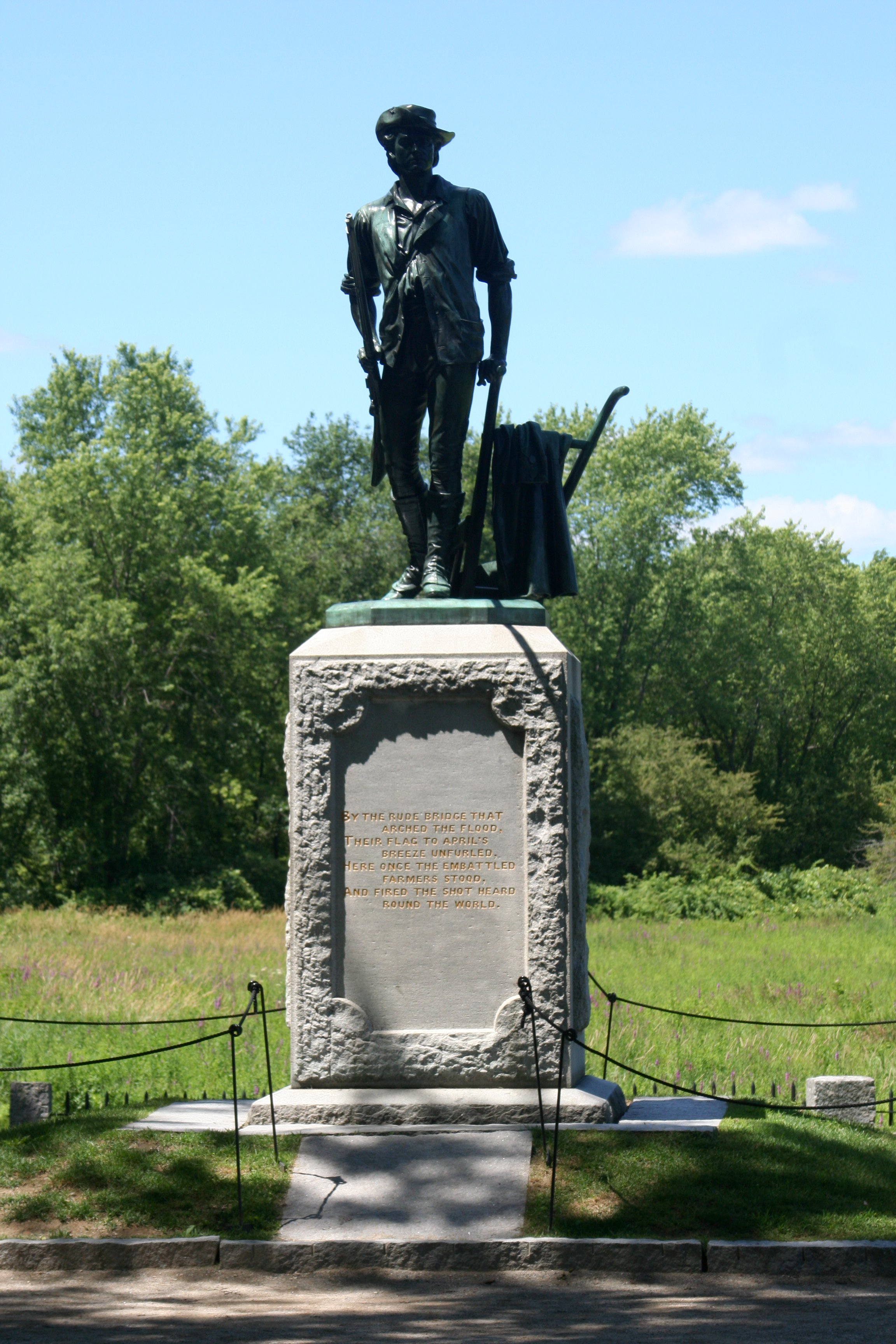 Statue memorializing the battle at Old North Bridge, Concord, Massachusetts, inscribed with verse from Emerson's