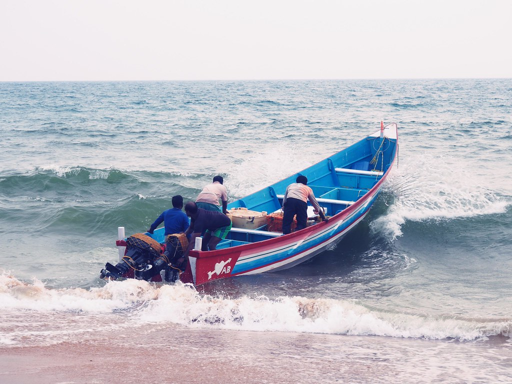 Fishermen boat in sea kerela trivandrum beach sunset_effected