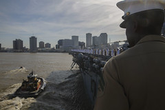 Sailors and Marines stand man the rails of USS Kearsarge.