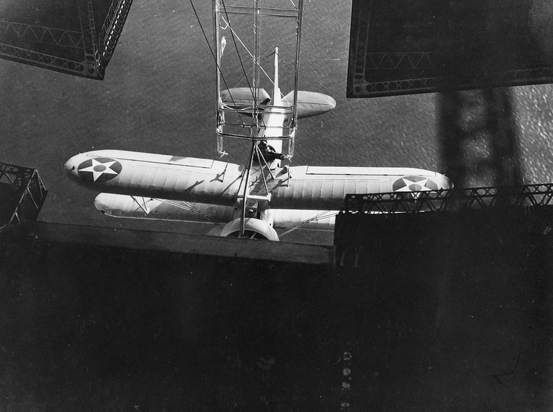 A view taken from inside the hangar on board the rigid airship Akron (ZRS 4) #OTD in 1932 showing an XF9C-1 Sparrowhawk hooked on to the trapeze used to launch and recover the fighters.
