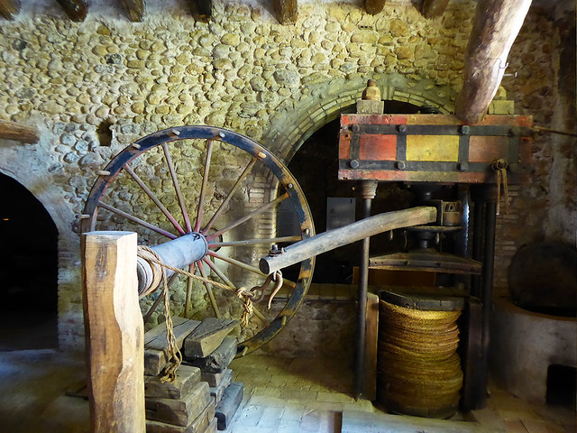A old olive press at Galliners, Catalonia is typical of historical agricultural machinery in Spain