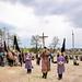 Темні фани символізують похоронний хід, у якому Тіло Христове несуть для покладення до гробу