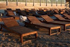 Beach beds under sunset light