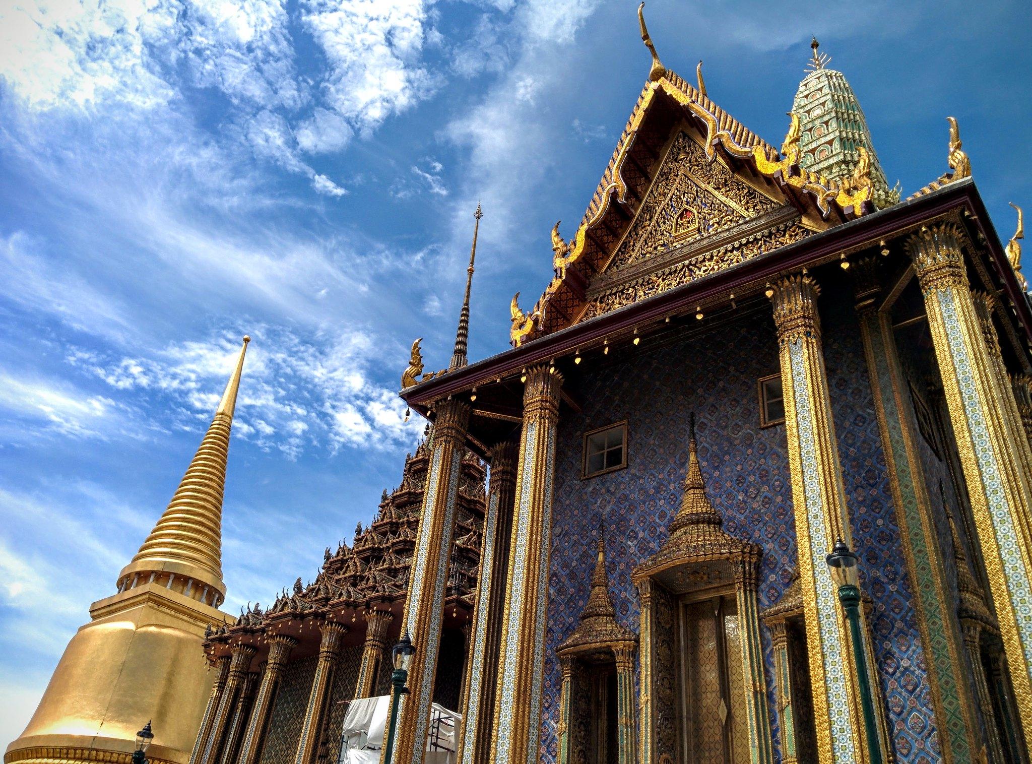 A golden temple against the blue sky