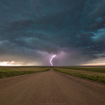 21. Mai 2018 - 11:08 - Lightning strikes directly in the middle of the road northwest of Sterling, Colorado. Storms were quite weak on this day, but the lightning shot made up for it. This shot was taken without a lightning trigger or even a remote shutter. I was extremely lucky.