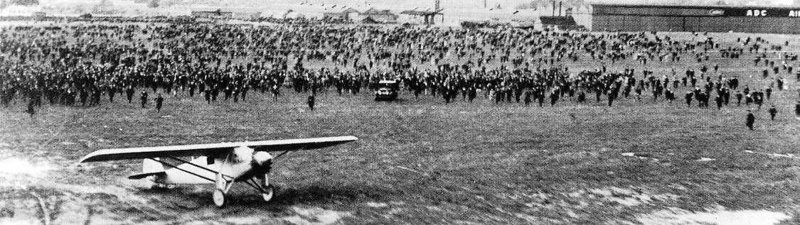 The crowd surges forward following Charles Lindbergh's landing at Croydon Aerodrome in South London, England, on May 29, 1927
