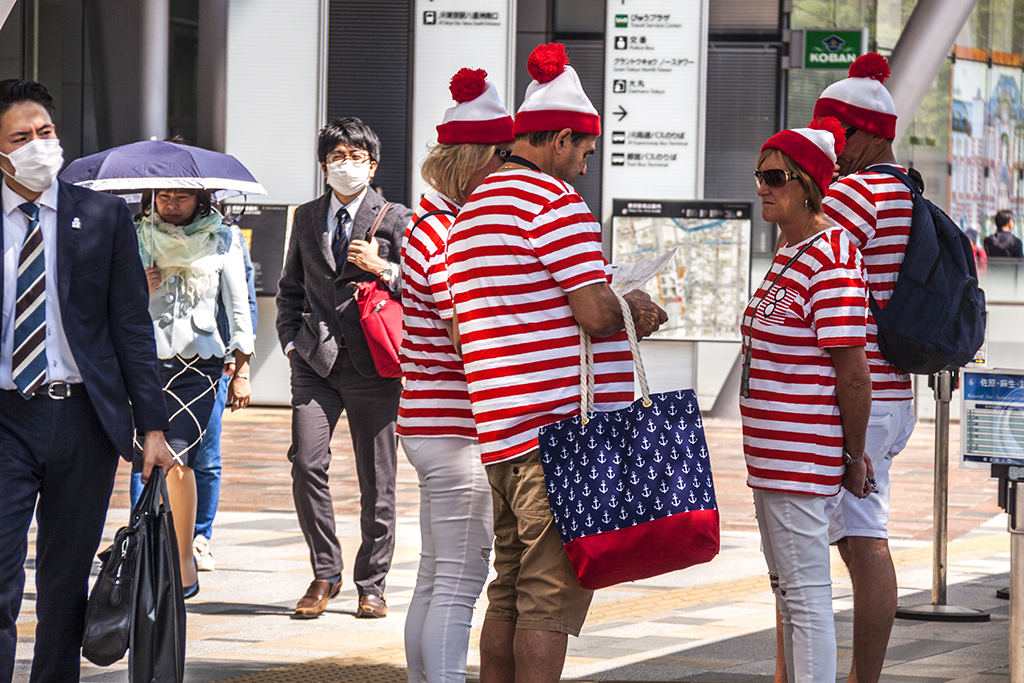 Westerners in red, white and blue outside Tokyo Station--Tokyo