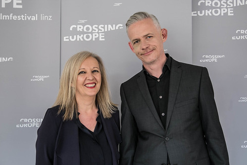 CE 18 - opening ceremony // Christine Dollhofer (Festival Director), Neil Young (Moderator) // photo © Christoph Thorwartl / subtext.at