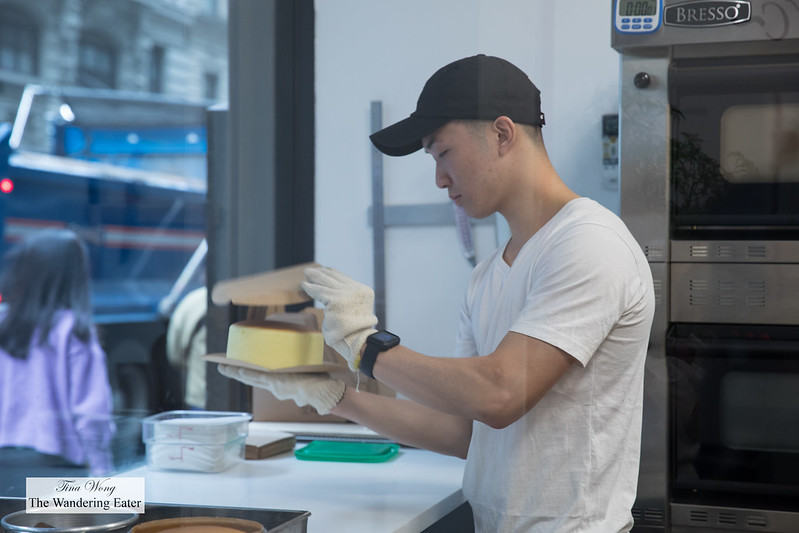 Employee flipping the piping hot Original Bouncy Cheesecake