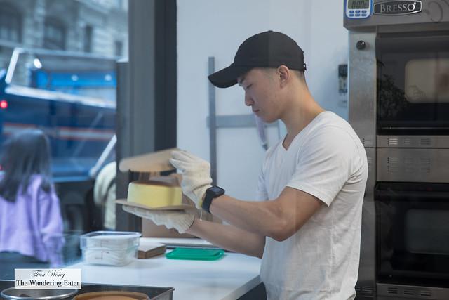 Employee flipping the piping hot Original Bouncy Cheesecake