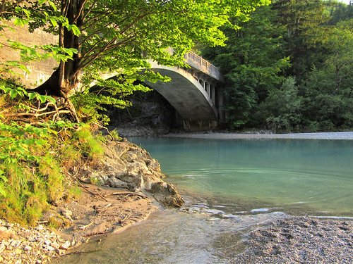 Lech River in Austria with bridge and trees