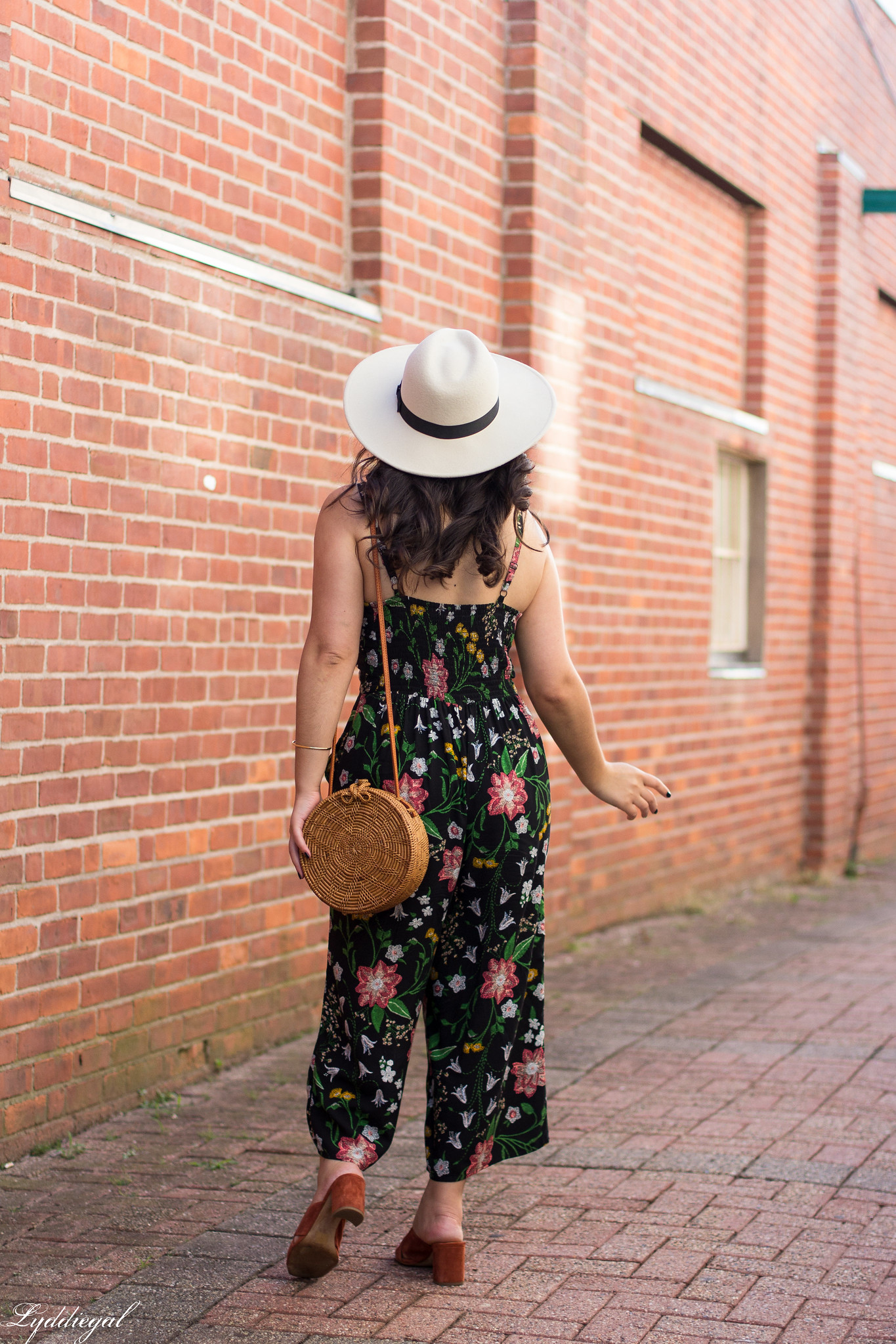 black floral jumpsuit, rust mules, cream fedora, straw bag-5.jpg